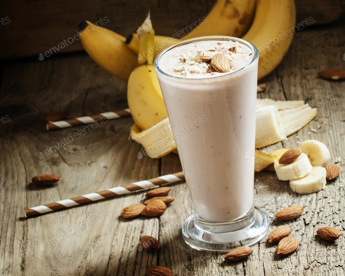 Banana smoothie with milk, ground almonds in a large cup