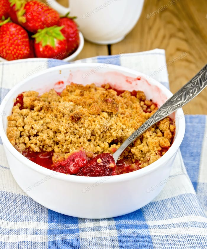 Crumble strawberry in white bowl on board