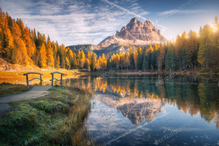 Lake with reflection in mountains at sunrise in autumn