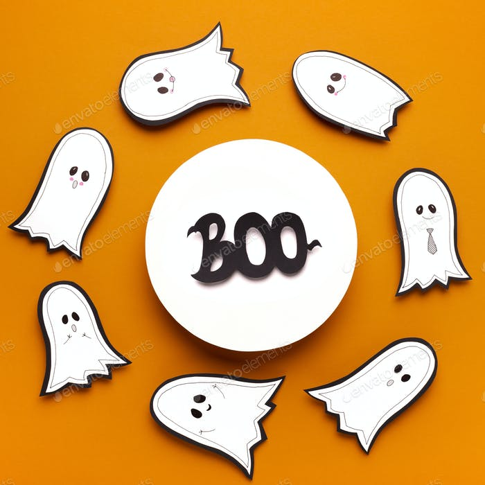 Scary halloween text boo in round frame on orange background