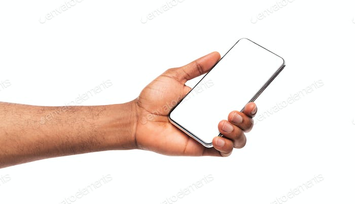Modern smartphone with blank screen in man's hands