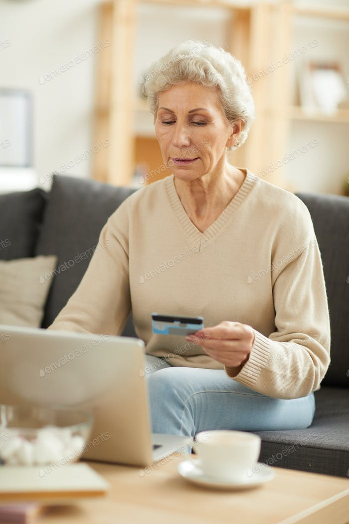 Senior Woman Paying Taxes
