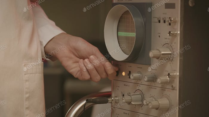 Scientist using an old machine in the laboratory