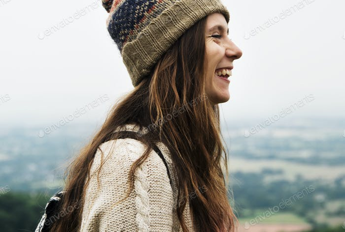 Side view of smiling woman enjoying the nature