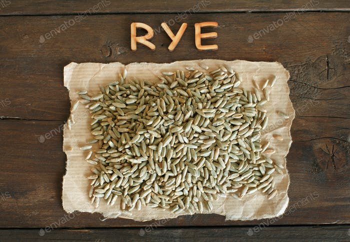 Pile of Dry Raw Rye Grain with a word Rye
