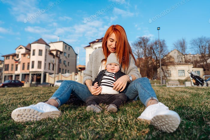 Mother and son on the grass