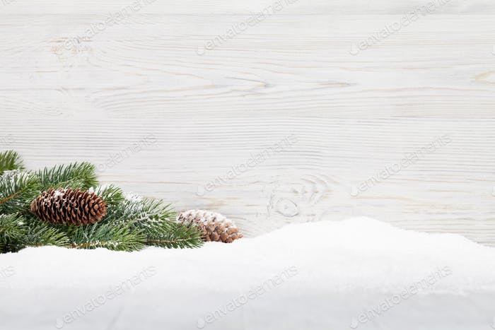 Christmas fir tree branch on wooden background