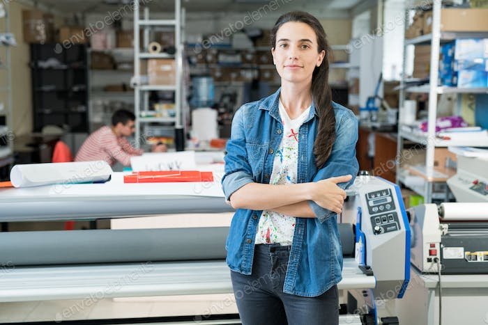 Confident female worker of printing house
