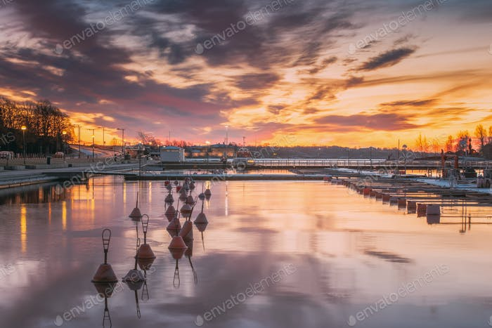 Helsinki, Finland. Landscape With City Pier, Jetty At Winter Sunrise Or Sunset Time. Tranquil Sea