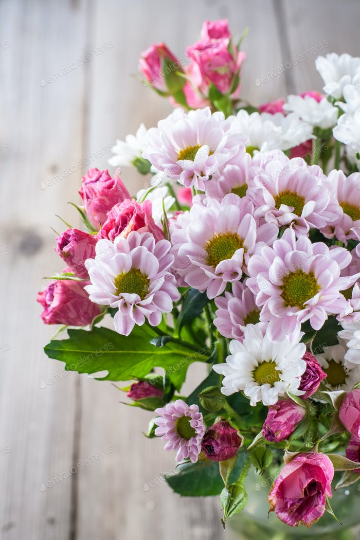 Flowers chrysanthemums and roses