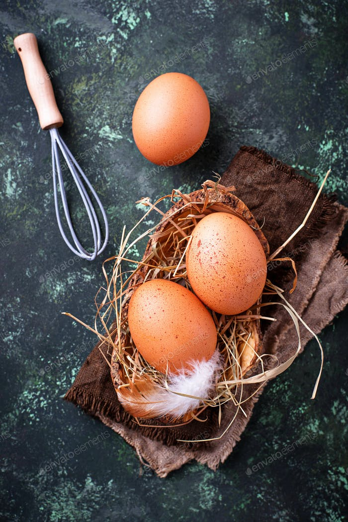 Raw chicken eggs and whisk