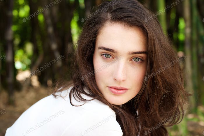 Attractive young woman in forest