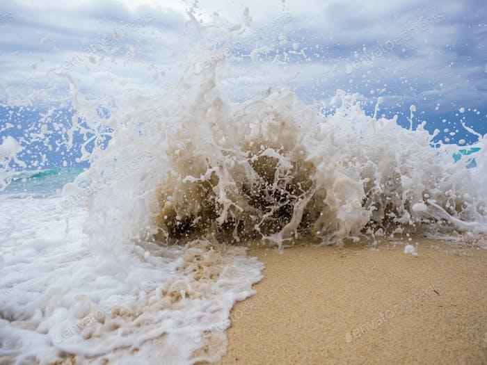 waves breaking on a stony beach