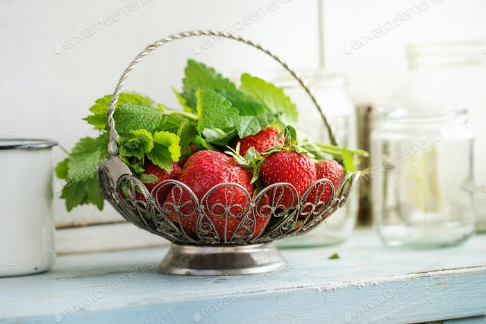 Fresh strawberries and melissa herbs