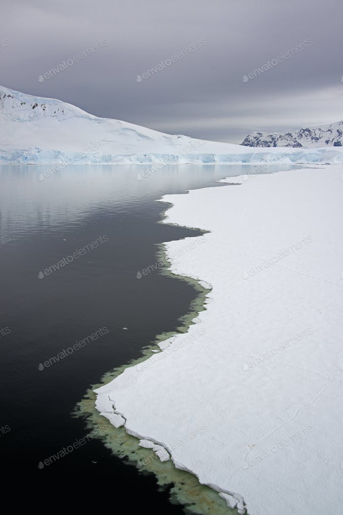 View from above, of melting sea ice off the shores of islands in antarctica.