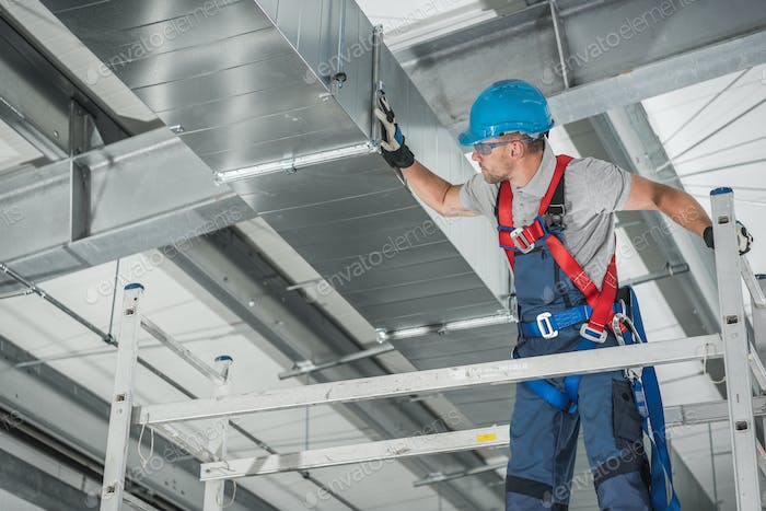 Professional Technician Worker Finishing Newly Assembled Air Vent Shaft