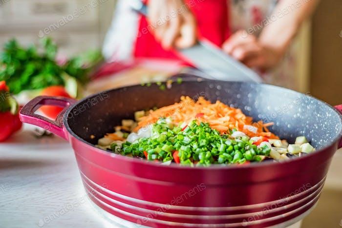 Chopped fresh vegetables in saucepan. Cooking vegetables