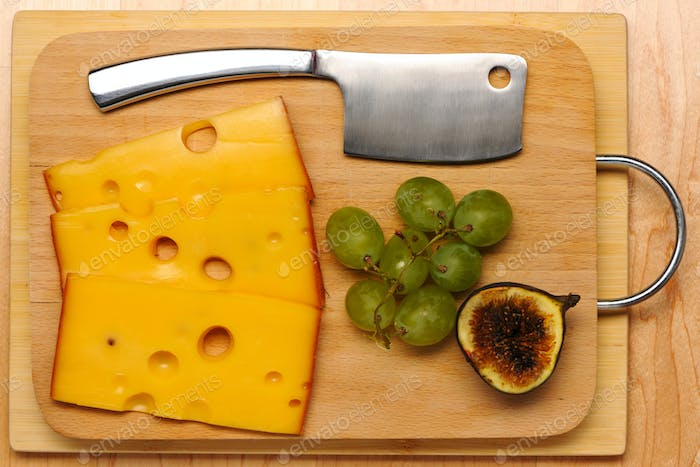 Swiss cheese and knife