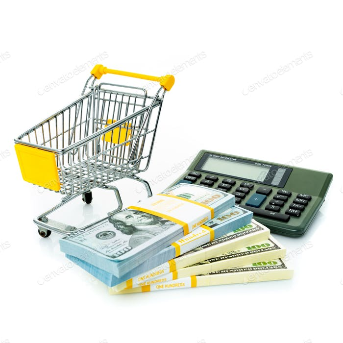 Shopping cart, dollars and calculator. Shopping consept