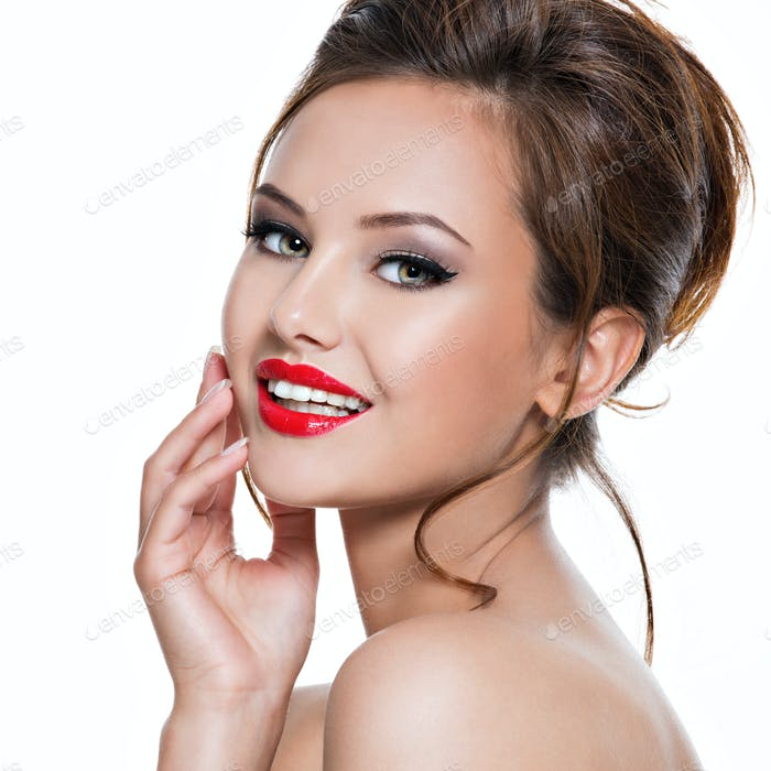 face of beautiful expressive woman with red lipstick on the lips