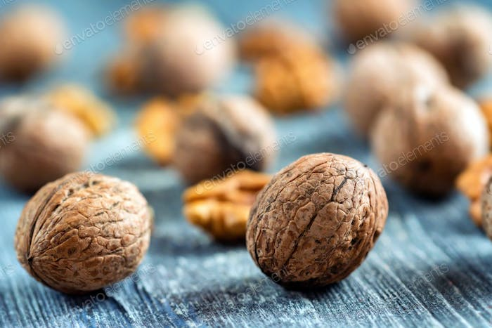 Walnuts and kernels on wooden backgound
