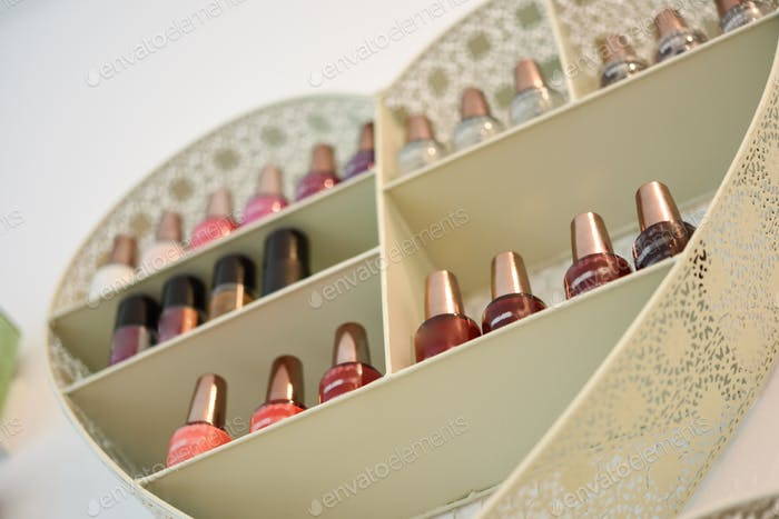 Bookcase with nail polish with heart shape in cosmetic section