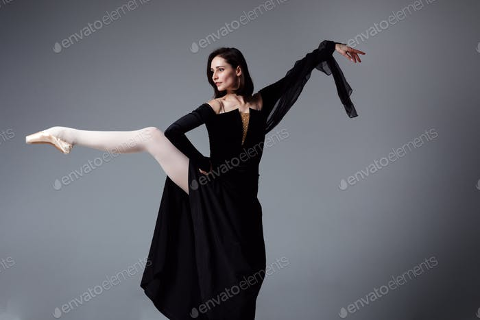 Slim ballerina in a black long dress