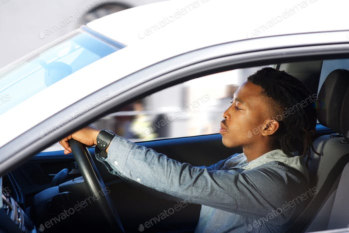 young black man driving car