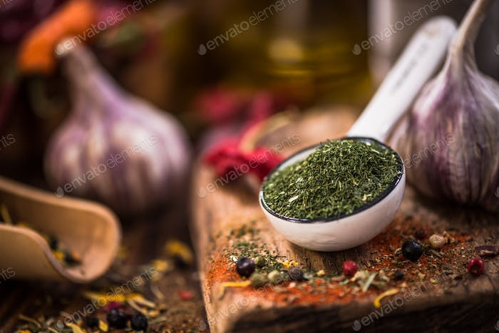 Dried dill on spoon. Spices and herbs