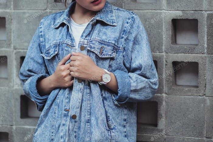 Woman on blue jeans jacket