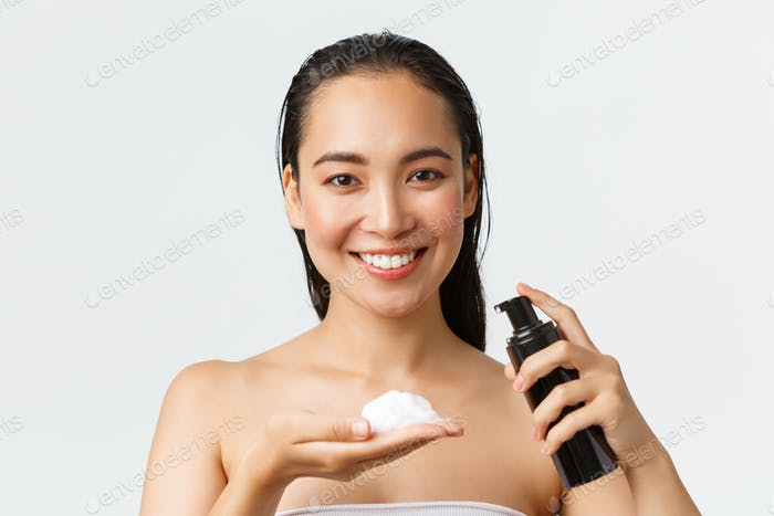 Skincare, women beauty, hygiene and personal care concept. Close-up of beautiful smiling asian woman