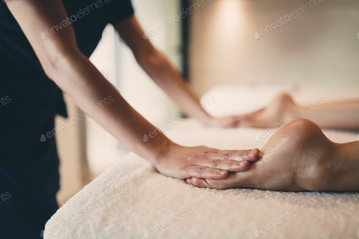 Foot and sole massage in therapeutic relax treatment