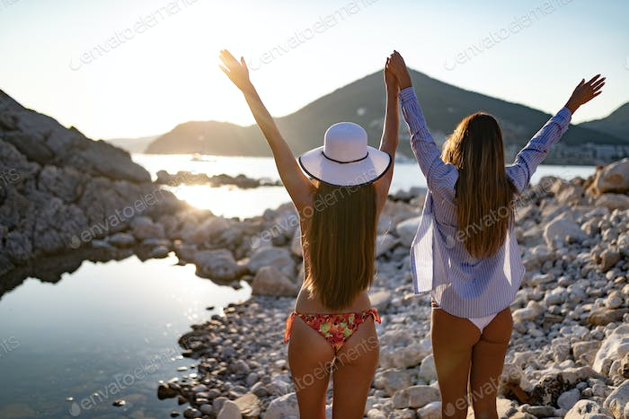 Sexy girls friends having fun on beach. Summer holidays and vacation