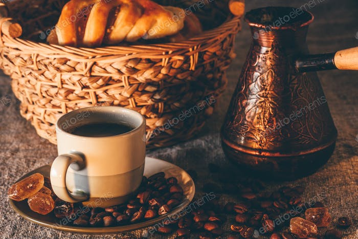 Cup of turkish coffee with cezve