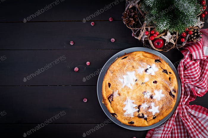 Christmas fruit cake, pudding on dark table. Top view, overhead, copy space.