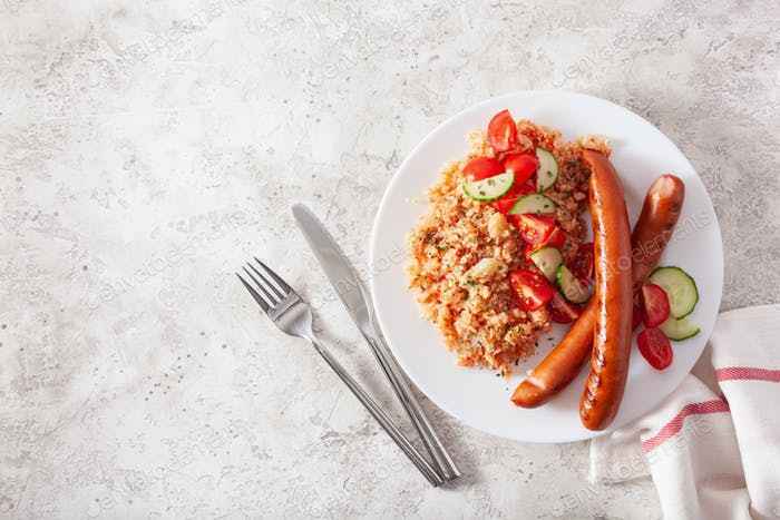 ketogenic paleo diet lunch. cauliflower rice and grilled sausages