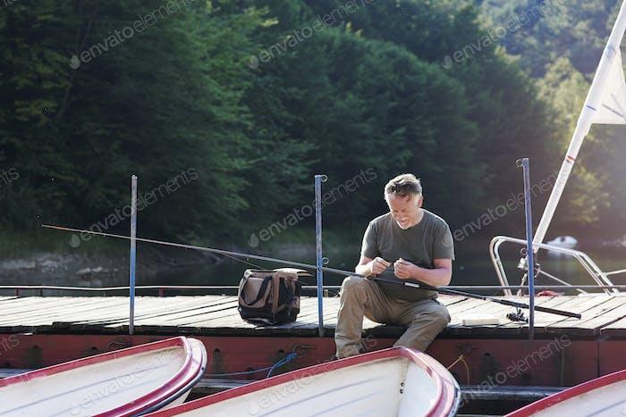 Mature men make preparations for fishing