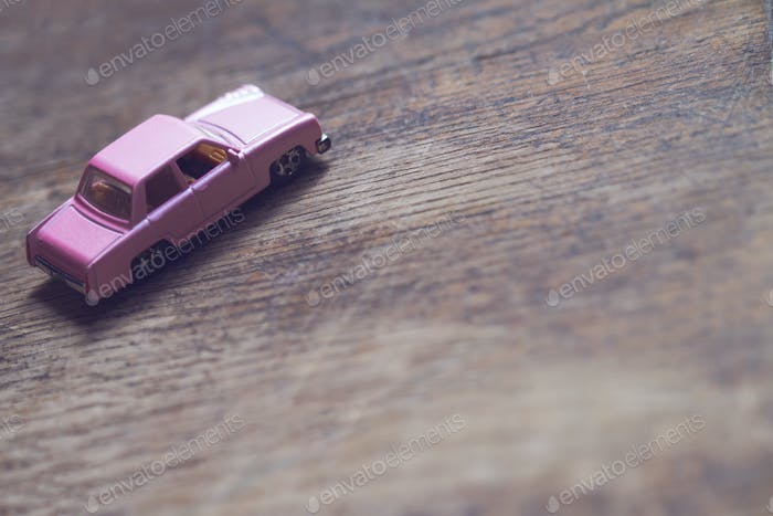 closeup of vintage toy pink car