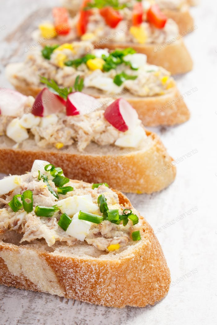 Sandwiches or baguette with mackerel or tuna fish paste, healthy nutrition