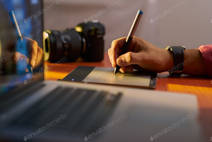 Artist Photographer Retouches Photo On Computer Graphic Tablet
