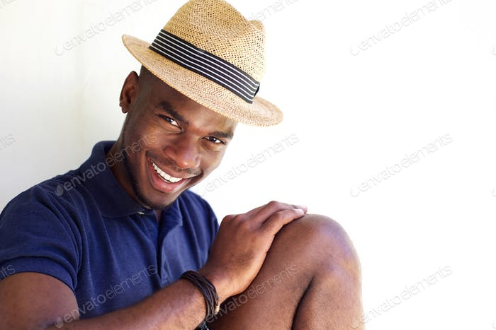 Happy young african american man in hat