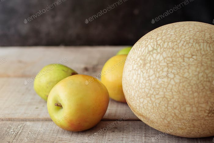 Apples on wooden floor