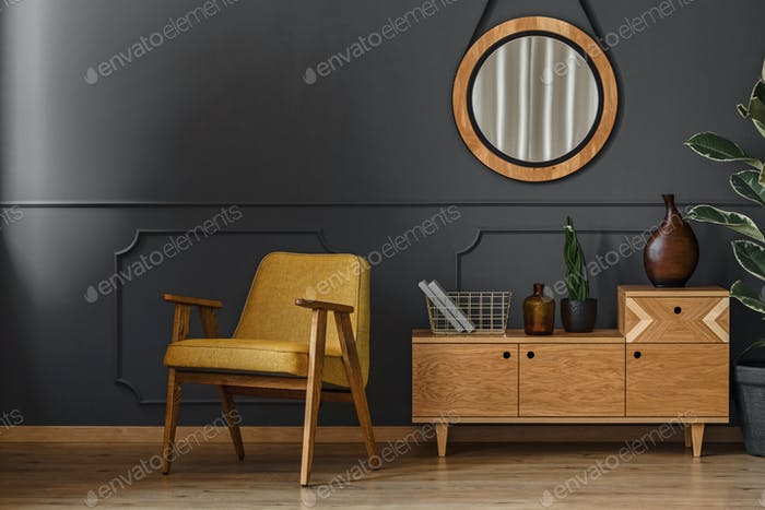 Mirror, cupboard and armchair
