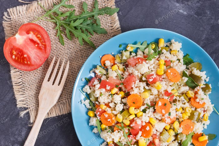 Fresh salad with couscous and vegetables. Light dietary vegan meal