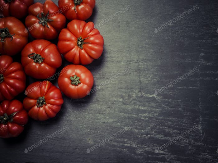 Marmande tomatoes on slate background