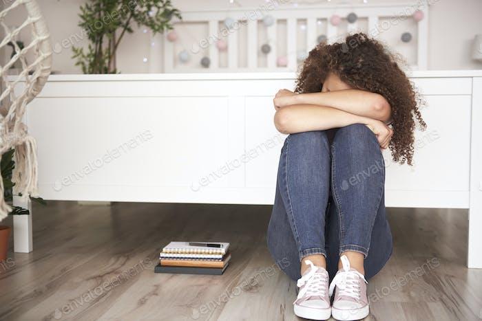 Depressed teenage girl in her room
