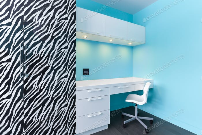 Zebra and white cabinets study desk