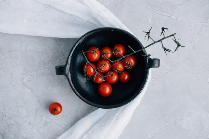 Fresh Cherry Tomatoes in Rustic Bowl