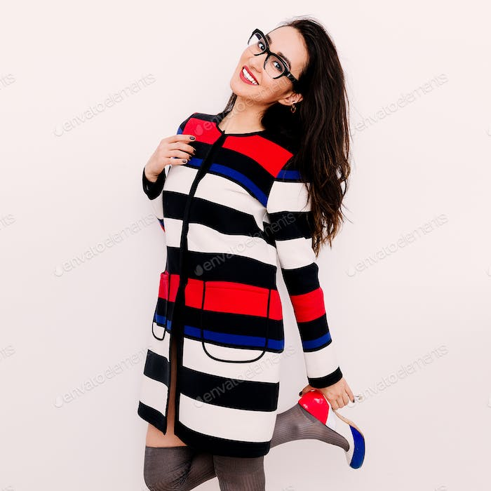 Happy Brunette in striped coat and stylish Shoes.  Fashion mood