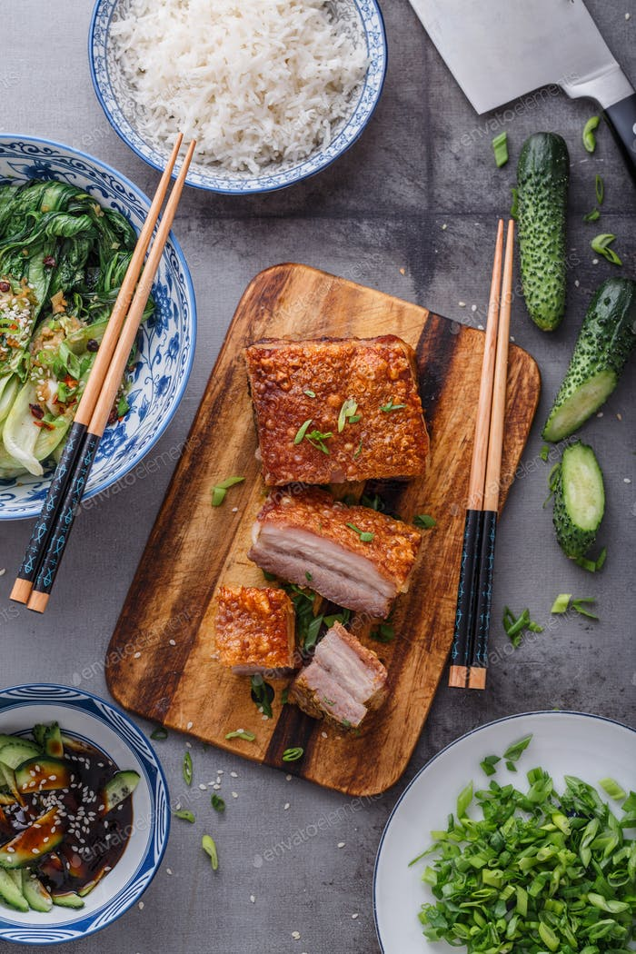 Chinese roasted pork belly on wooden cutting board